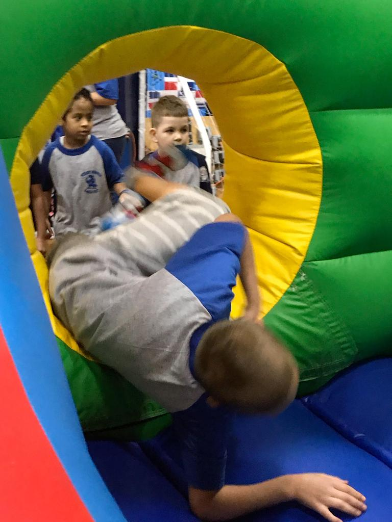 first boy entering the bouncy house