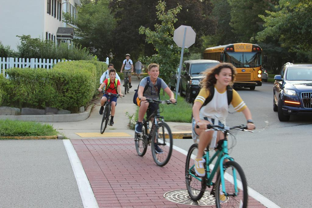 Students riding bikes to school on the 1st day.