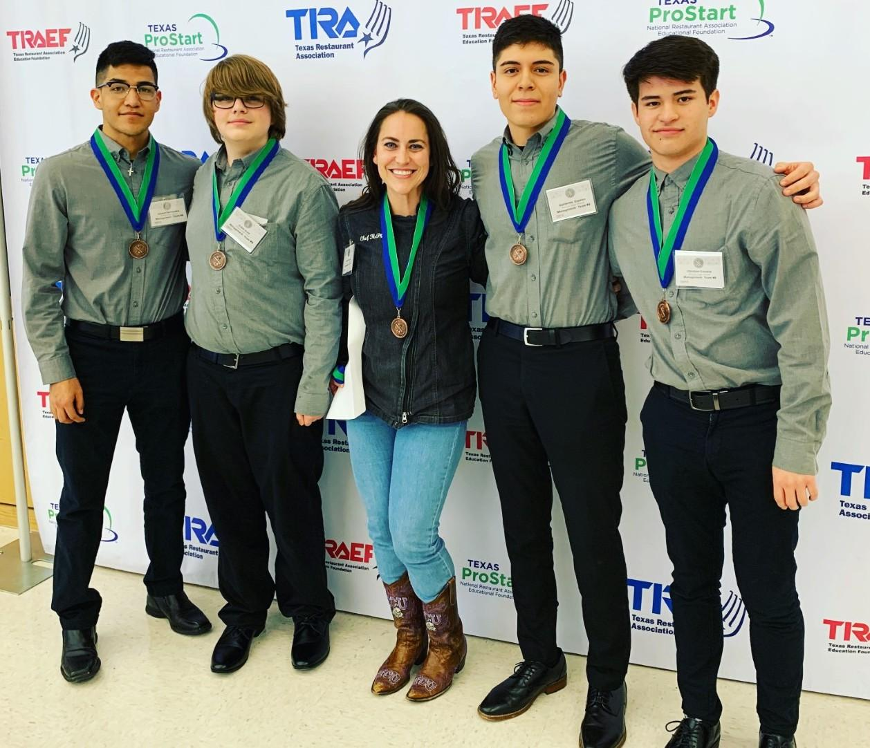 Brewer High School culinary arts students won fourth place in the management competition at ProStart, and they'll advance to state! Pictured l-r with Chef Kaylie McPherson are: Joseph Hernandez, Caleb Scott, Guillermo Esparza and Christian Cavazos.
