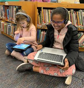 """Franklin 1st grader Rhyan Sporer (left) and 5th grader Hailey Latcha enjoy coding during """"Hour of Code"""" activities as part of Computer Science Education Week."""