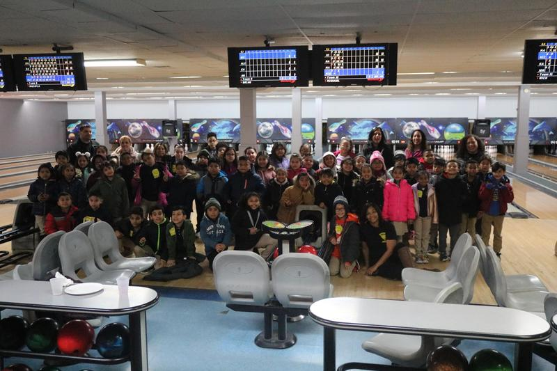 group photo of honor roll students and teachers at the bowling alley