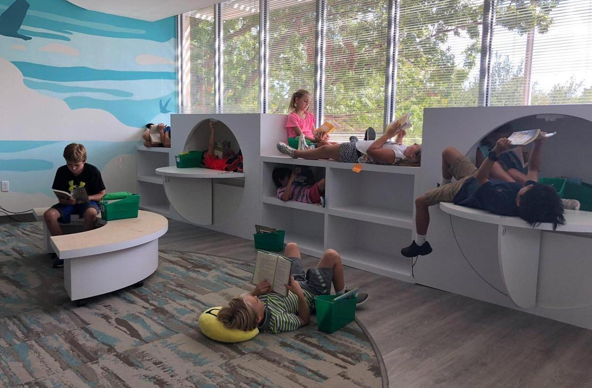 Students relaxing and reading books in the Armstrong Flexible Learning Space.
