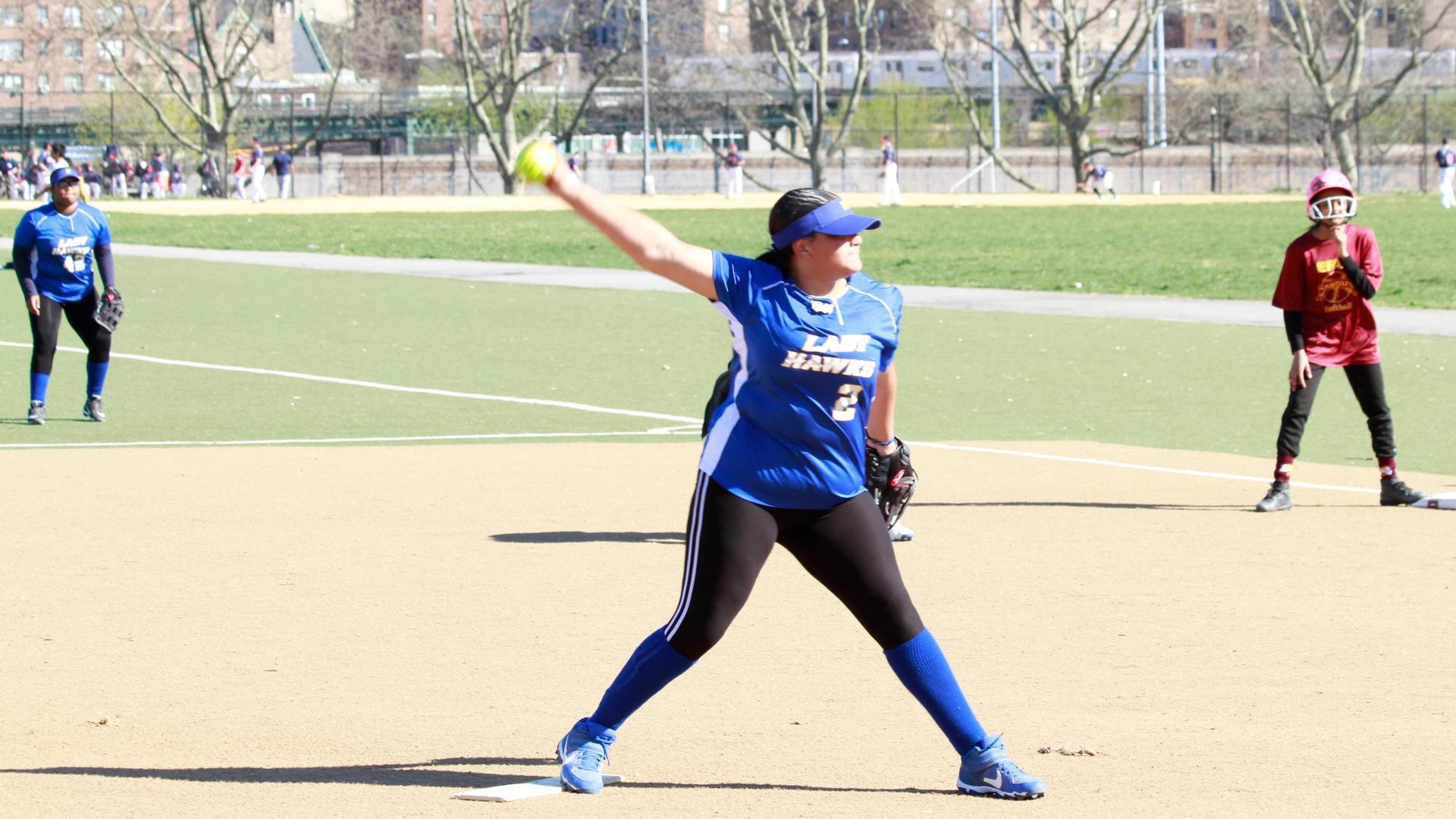 girl pitching a softball