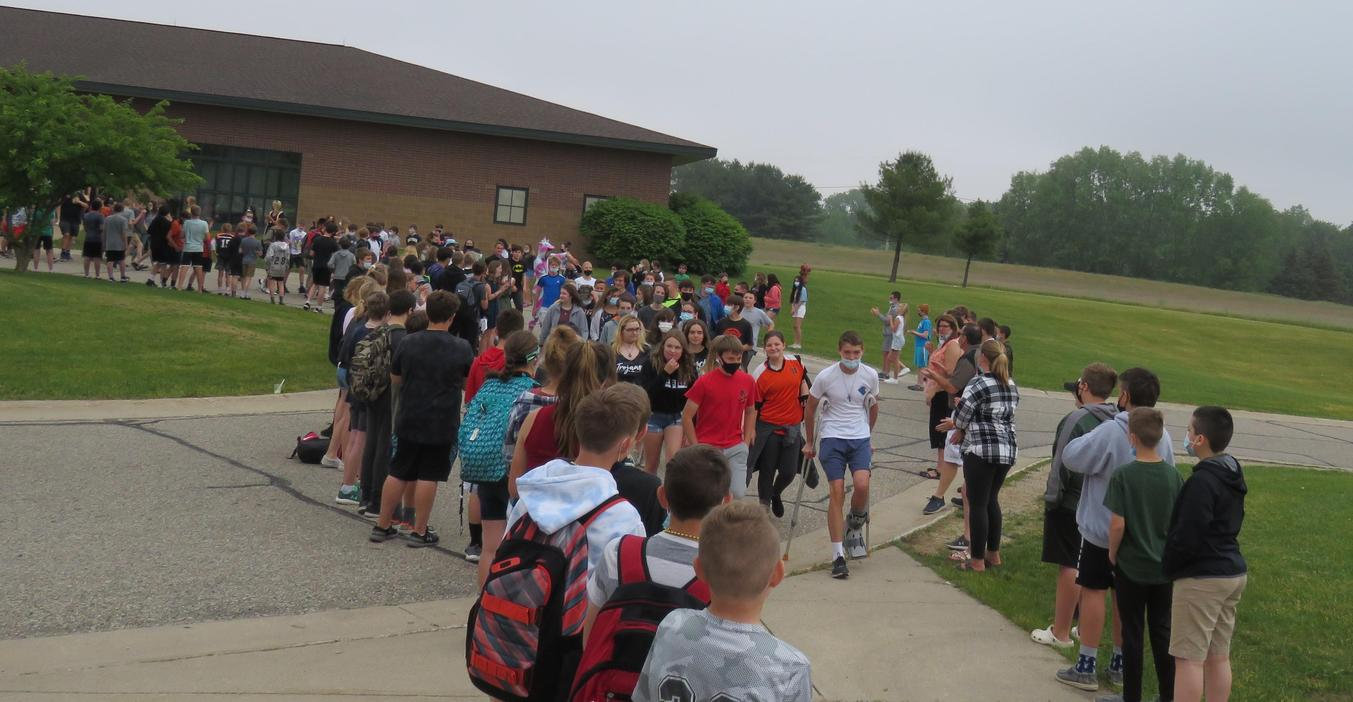 TKMS 8th graders take their final walk as middle school students through a tunnel of MS students and staff.