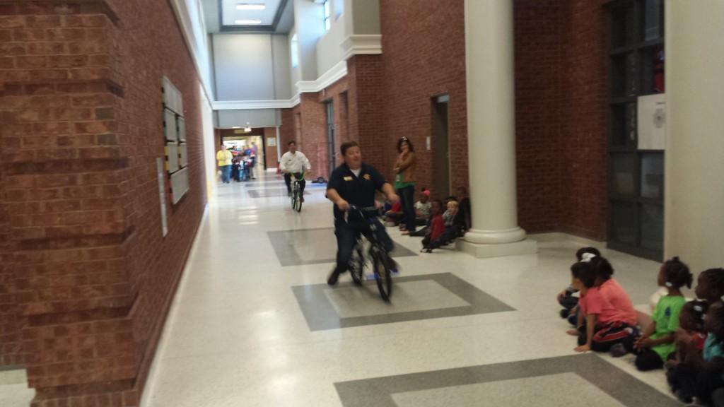 Administrators riding bikes at CCPS