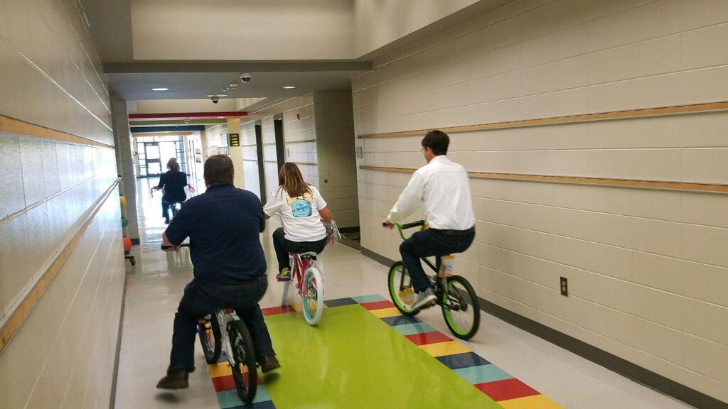 Administrators riding bikes