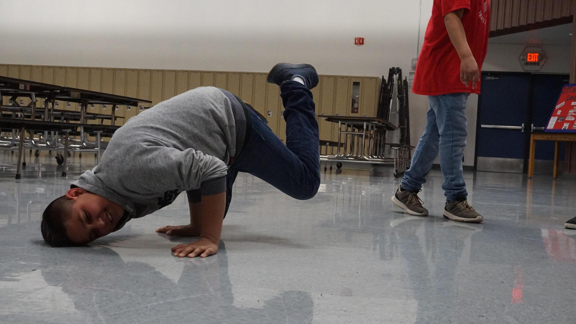 Male student practicing dancing