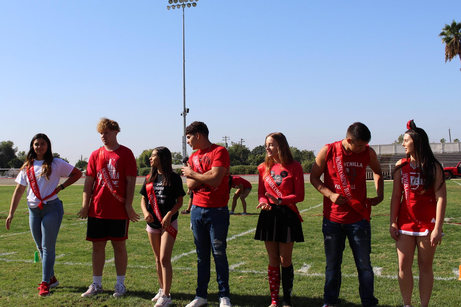 Homecoming king and queen candidates posing