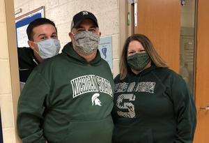 three middle school teachers in spartan shirts