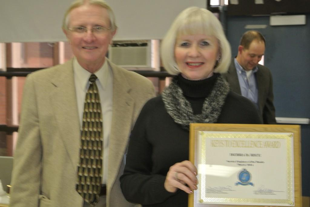 Debbie Rice receiving Keys of Excellence award