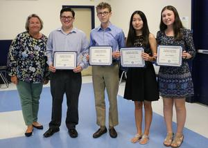 (L-R) Westfield High School seniors Ian Gurland, Aidan Kilbourn, Connie Liu, and Julia Tompkins were honored at the Sept. 17 Board of Education meeting as National Merit Scholarship Semifinalists.  Pictured here with Board of Education president Peggy Oster.