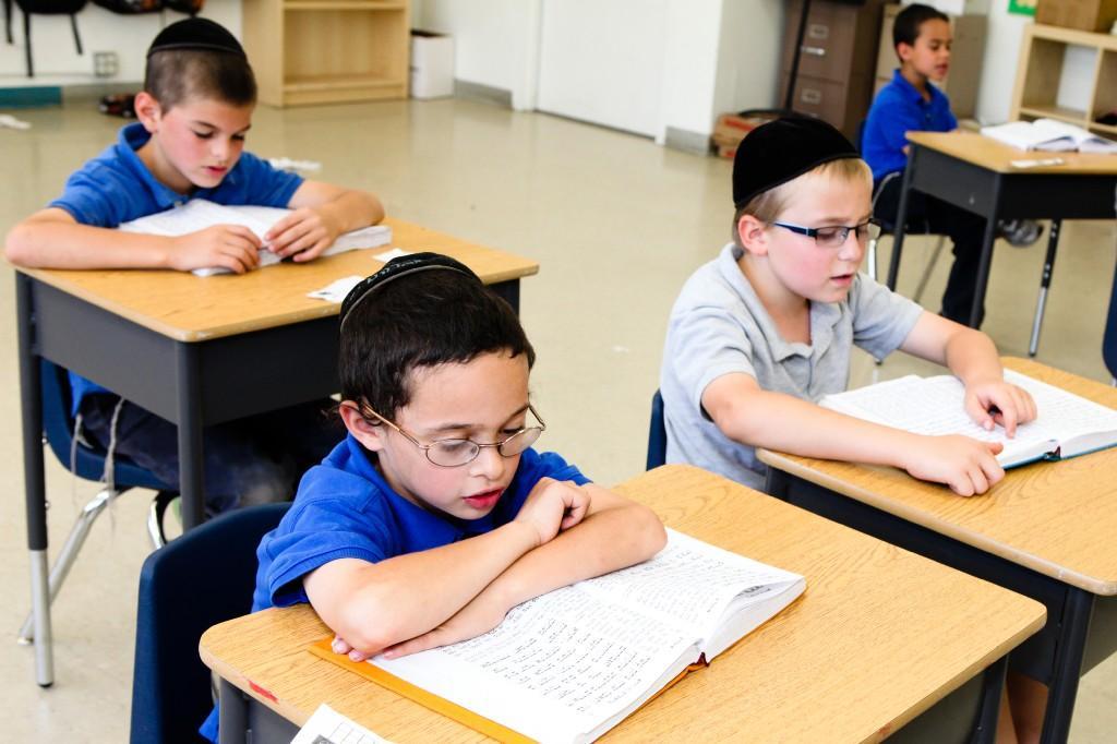 boys davening in their classroom