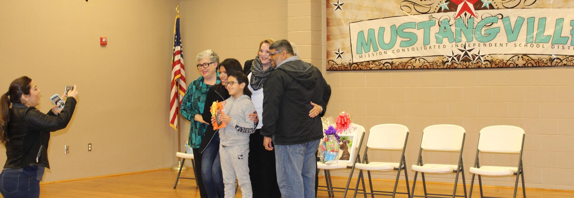 Joaquin with family and school board members