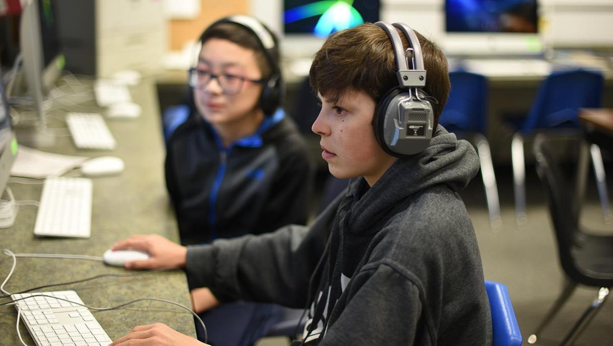Two middle school students at a computer