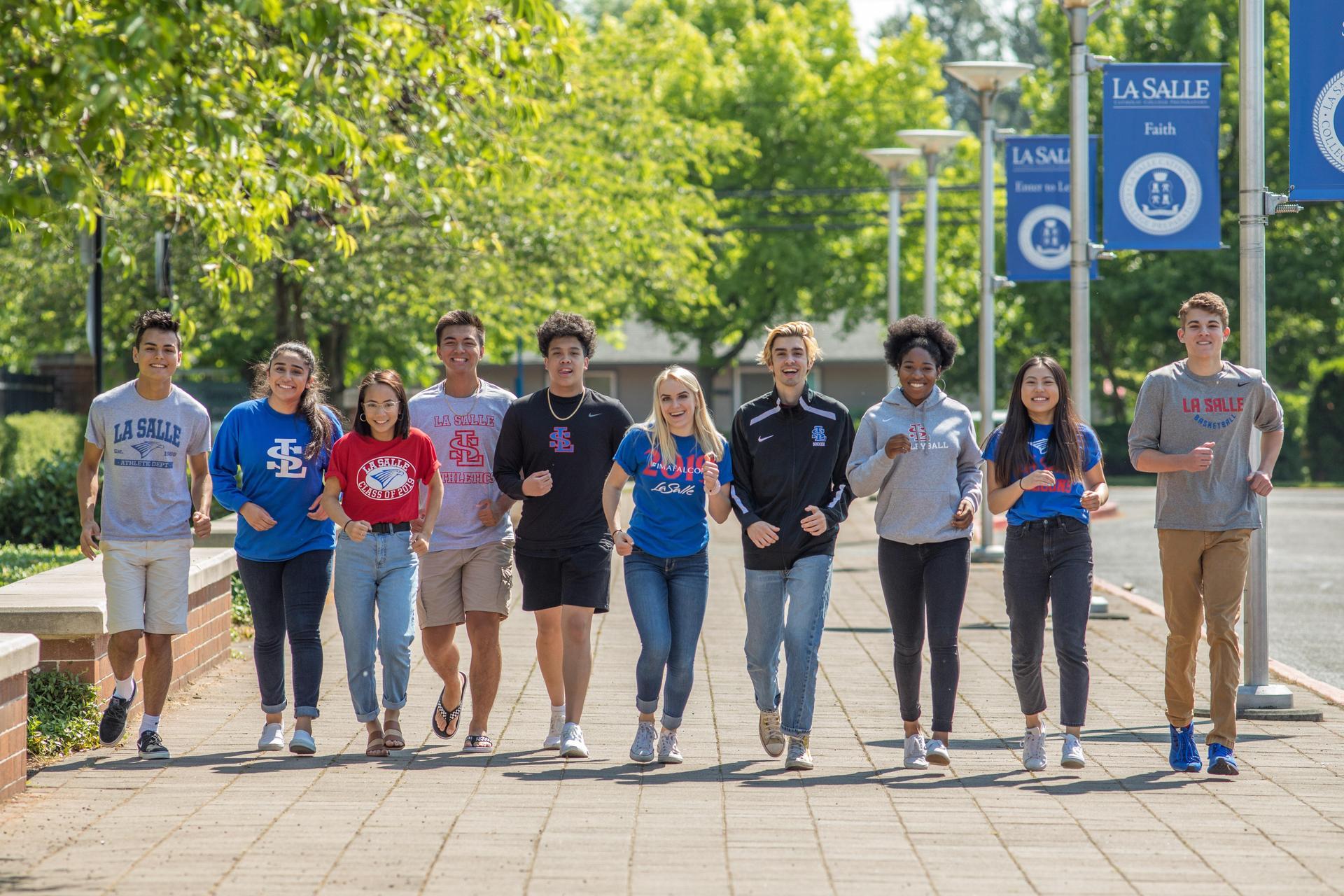students walking on sidewalk in front of school