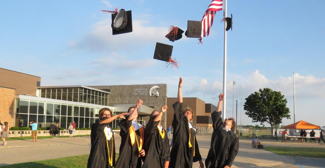 TKHS Class of 2020 graduates in a unique drive-in ceremony.