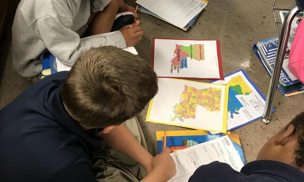 Mrs. Stelly's class using maps to learn about the different regions of Louisiana!