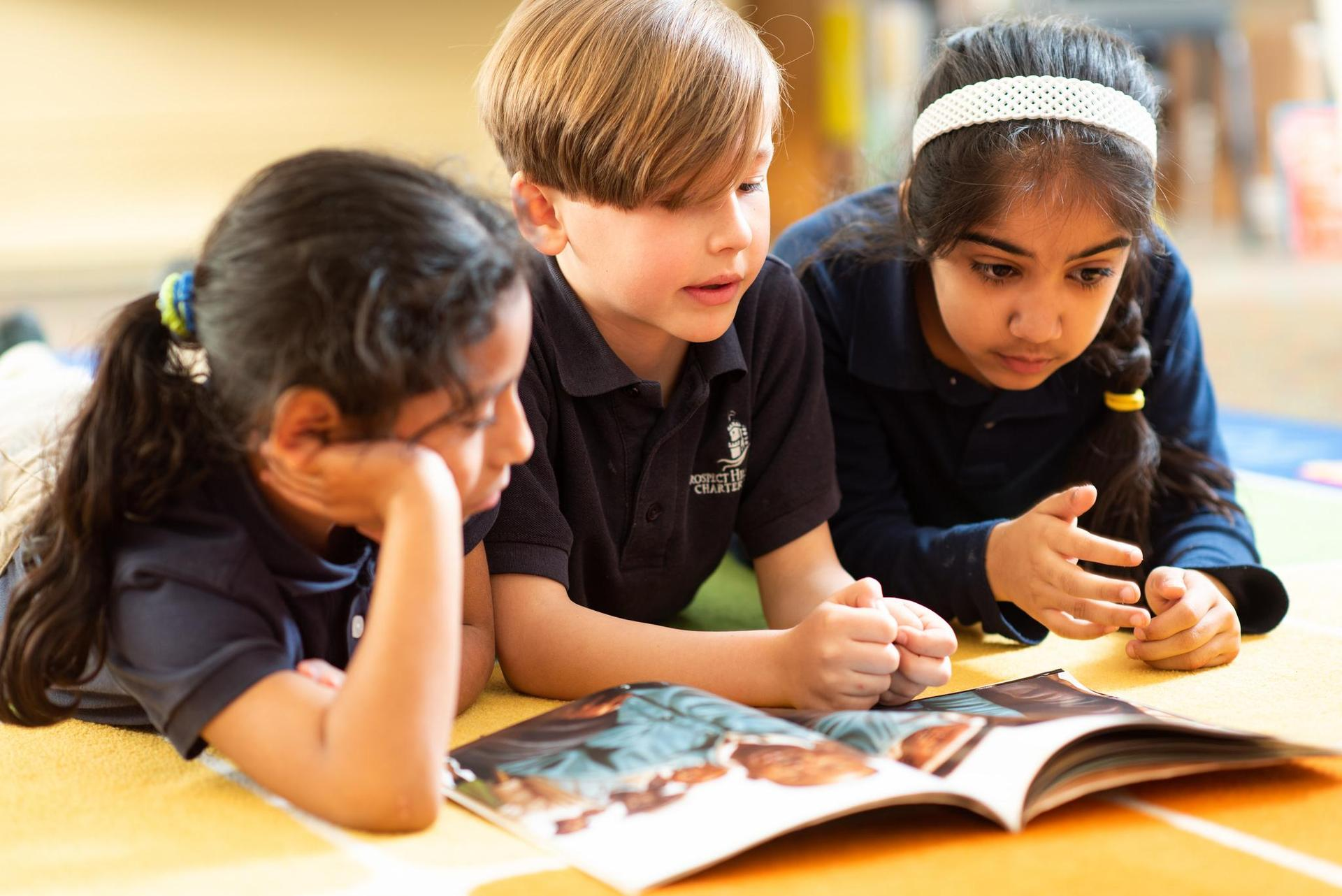 Early Childhood students reading together