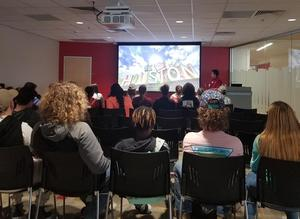 LJH students view informaitonal video at UH welcome center