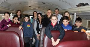 Photo of Franklin students and staff on bus, on the way to donate collected toys to charity in Newark.