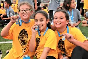 Tracy and Vineland elementary school students from kindergarten through sixth grade earn participation medals for completing the last mile of a marathon run on May 10, as part of Rod Dixon's Kids Marathon Run Club.