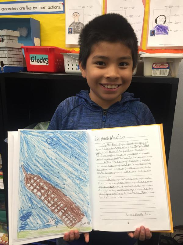 A student with their published story.