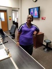 Mrs. Miles (Former Bookkeeper) in the office smiling.
