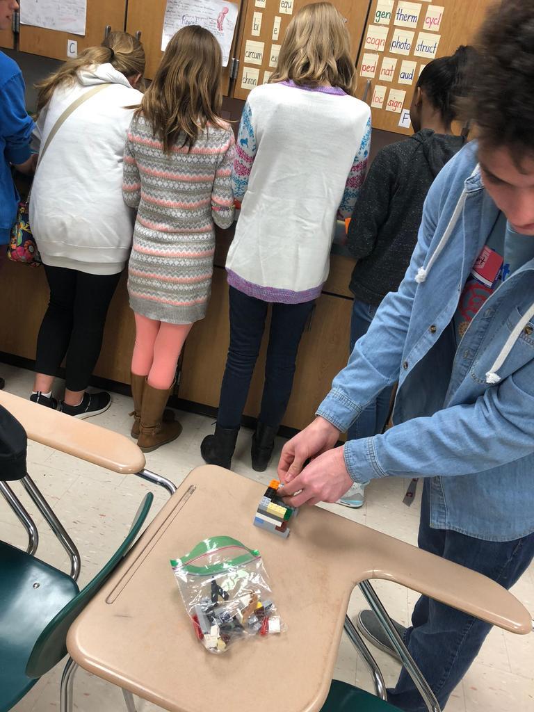 Mechatronics students build lego structures based on blueprints
