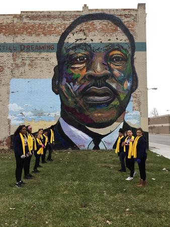 Picture of students of National School Choice dance team standing in front of MLK mural