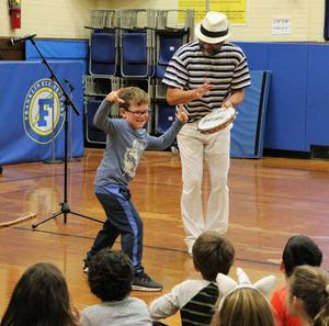 Franklin School 1st grader joins a lively performance by Ginga Brasileira on Nov. 19 as students explore the history, language and culture of Brazil through music and dance as part of a PTO-sponsored Cultural Arts assembly.