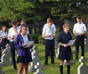 Students pray the rosary together at the Sisters Cemetery during OLSH Mission & Heritage Week