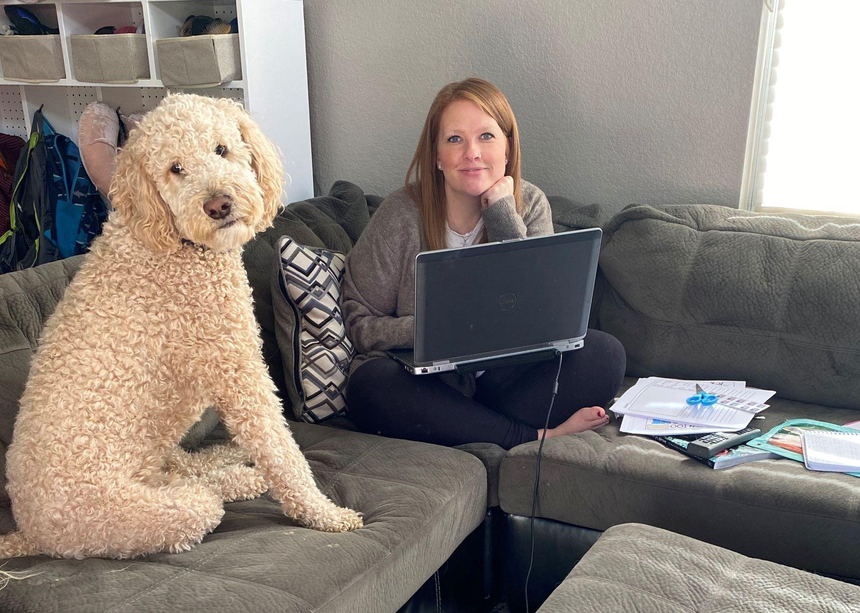 Woman working from home with very large dog.