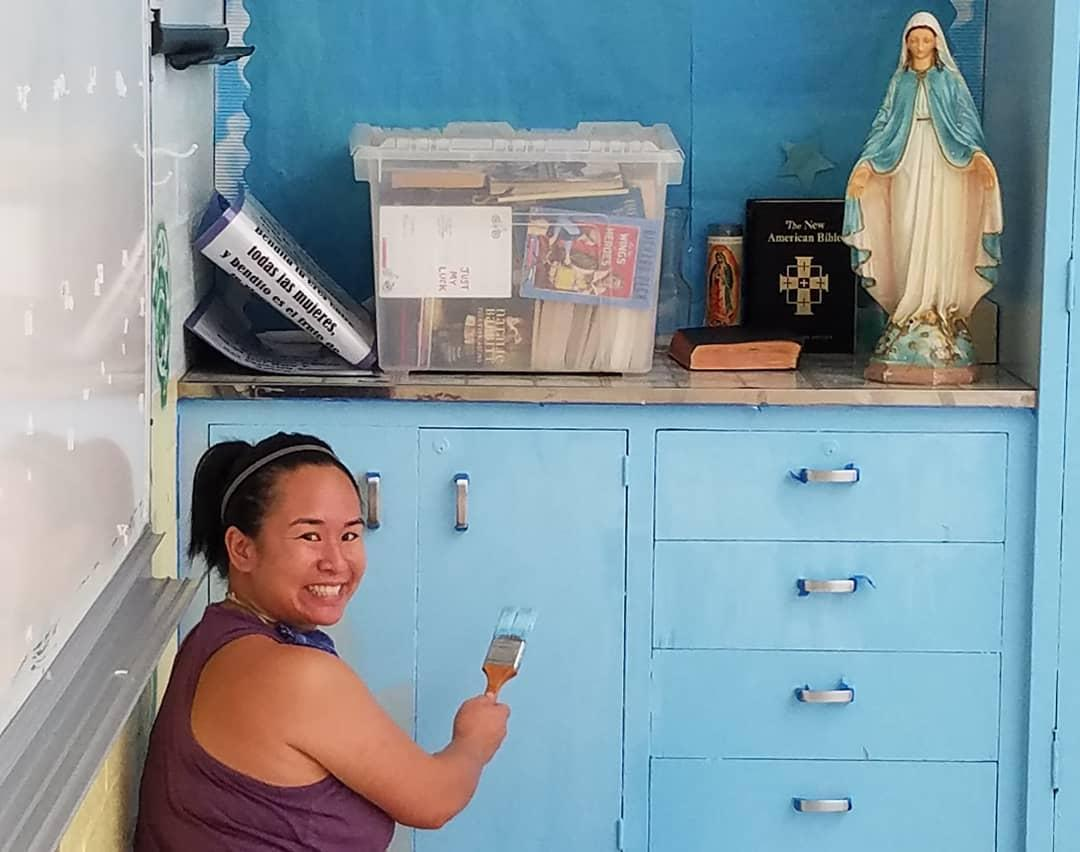 4th grade teacher, Mrs. Slanina, painting classroom cupboards