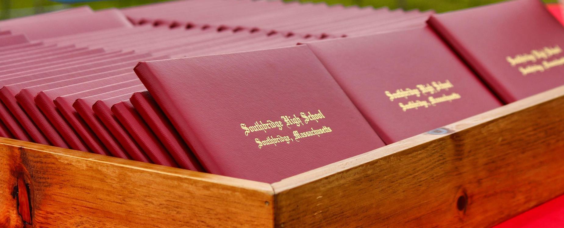 A tray of diplomas at a Southbridge High School graduation