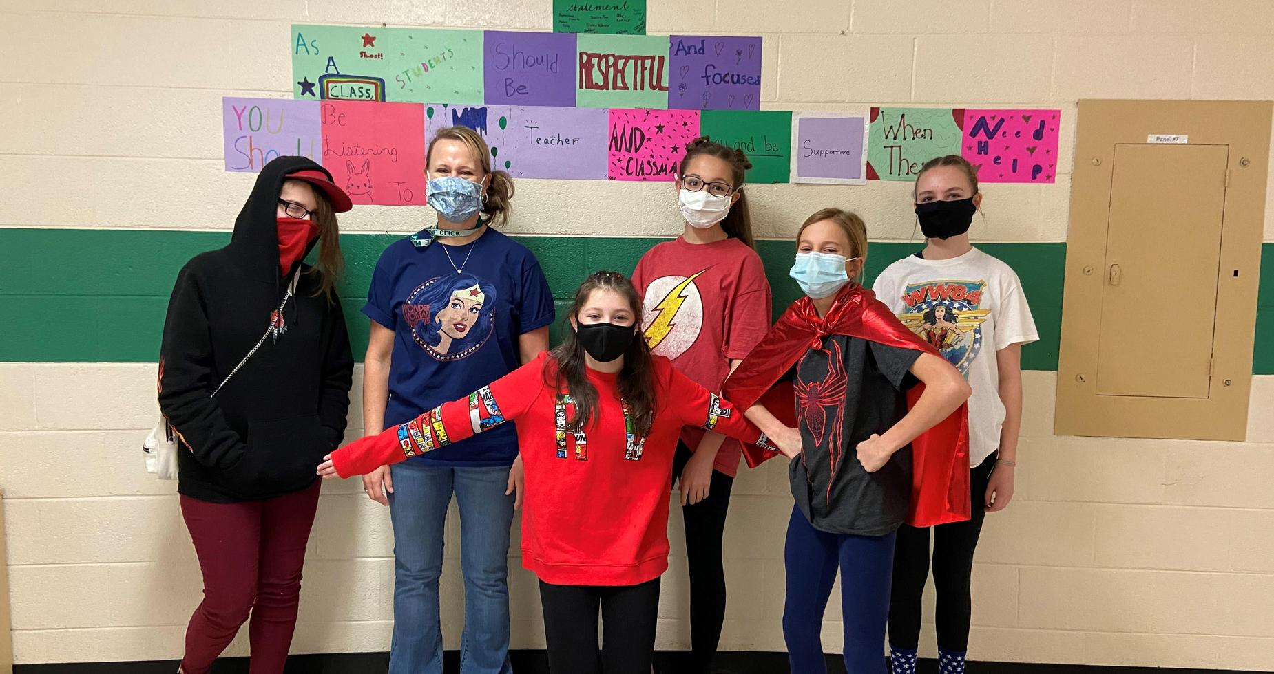 middle school students dressed up as super heros