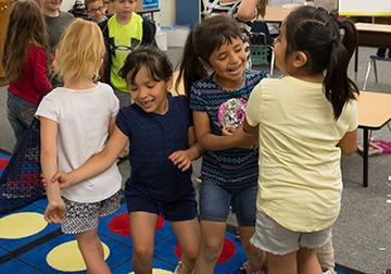 Children play during an educational game at Greenhurst Elementary