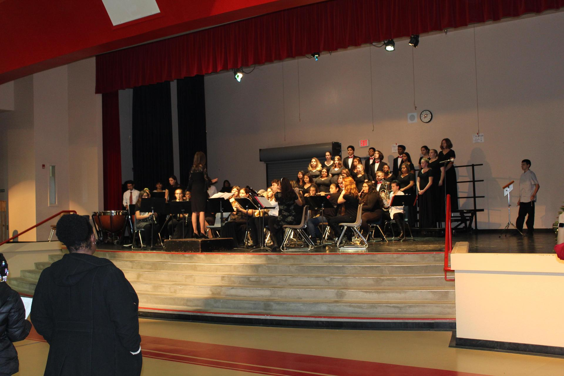 The CUHS Choir and Band perform together.