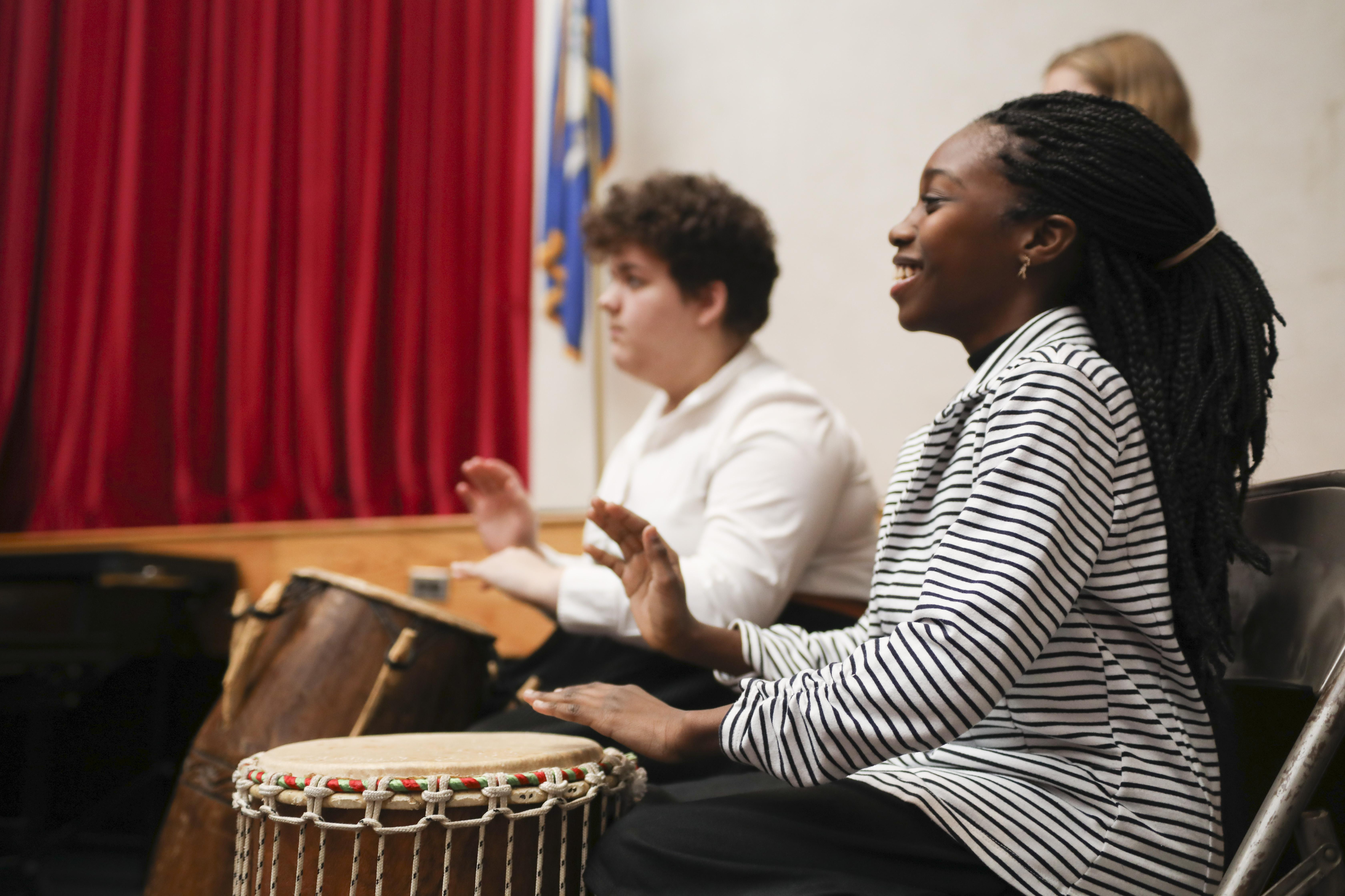 Two students drumming
