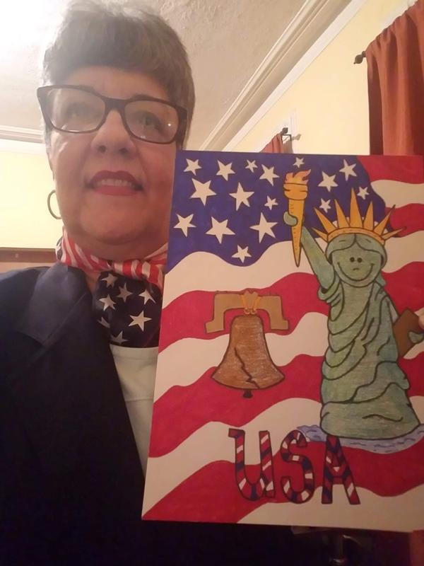 Teacher holding American symbols painting