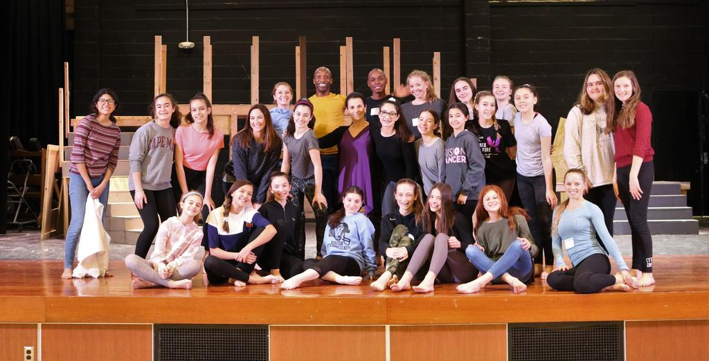 Photo of Edison students posing with members of the Carolyn Dorfman Dance troupe after participating in a master class.
