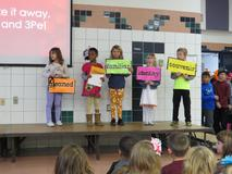 Students with Wildcat Word cards