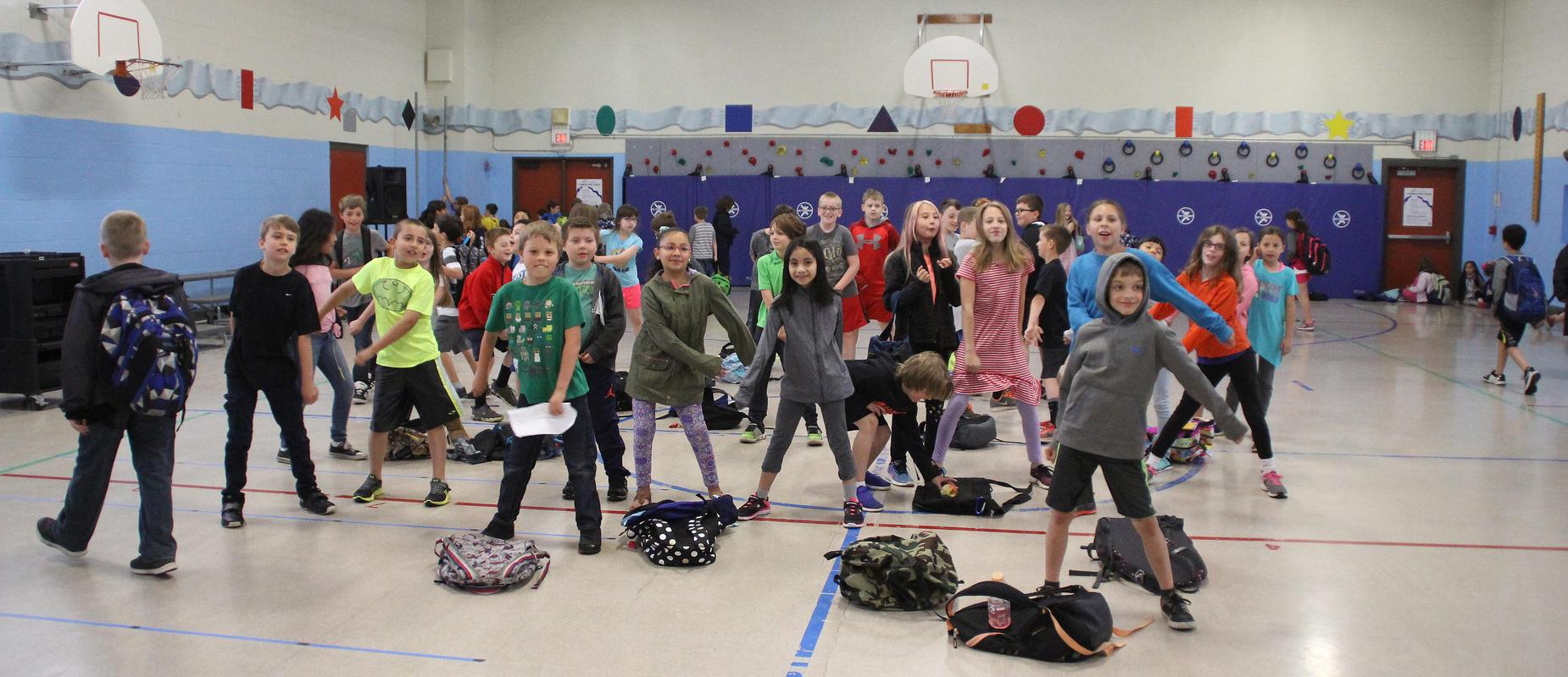 Students dancing before school