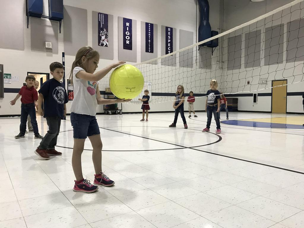 Playing Volleyball in PE