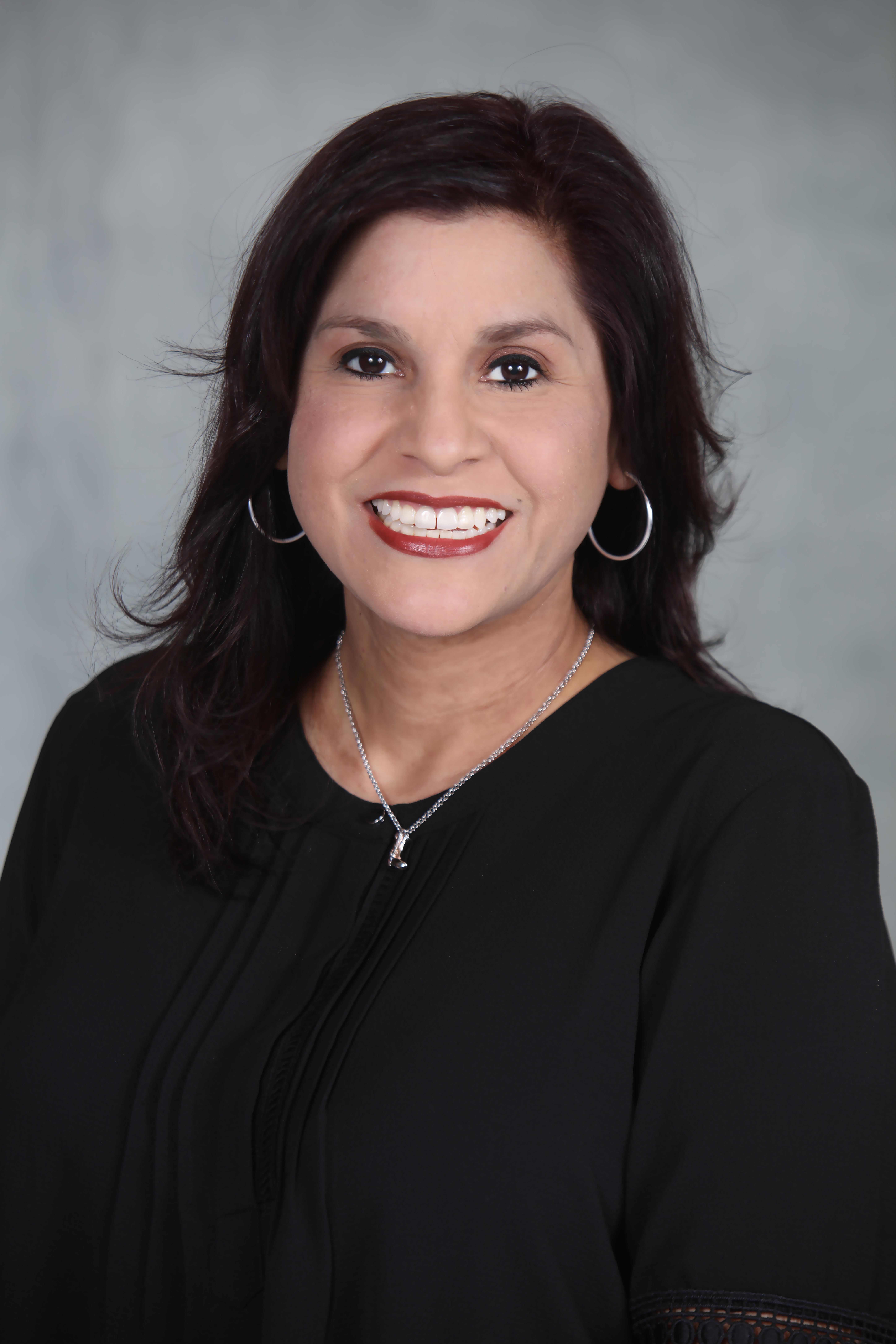Leticia Quintanilla- Travis