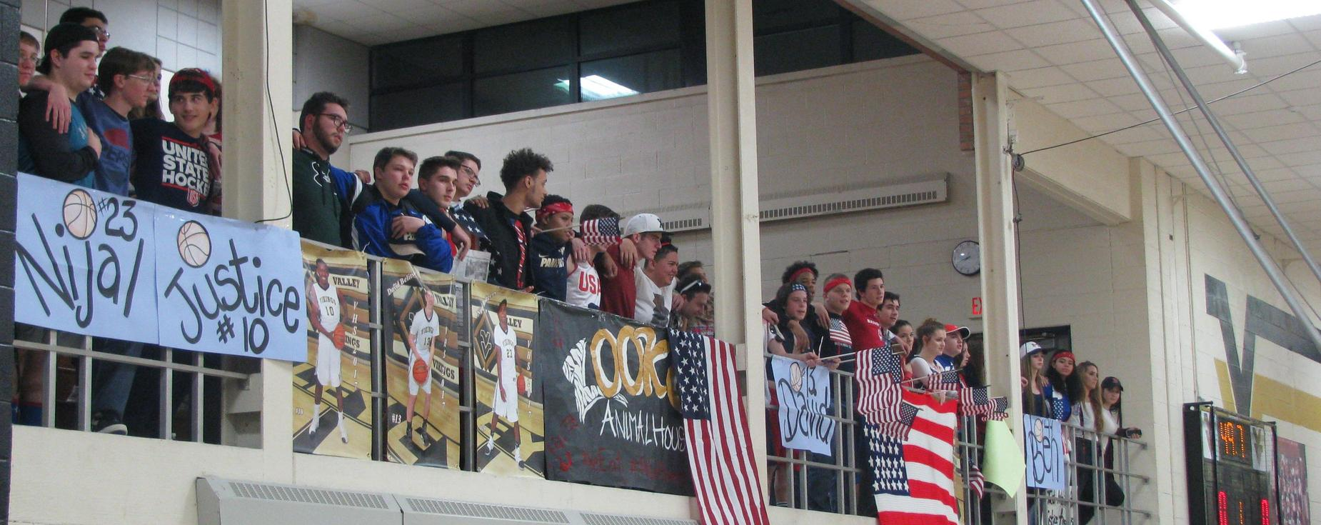 Valley High School fans cheering on their basketball team.