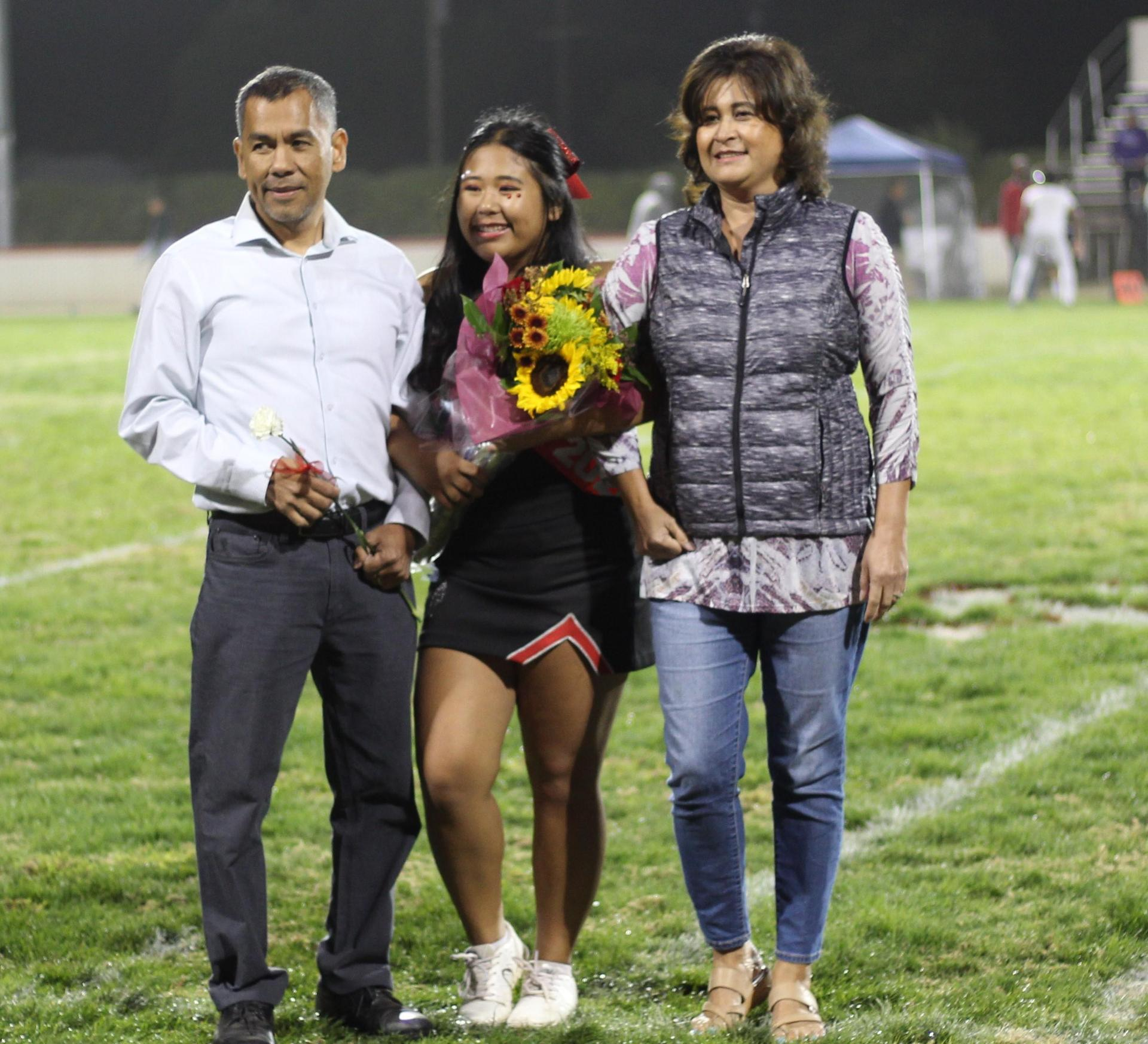 Senior cheerleader Bianca Solidum and her escorts.