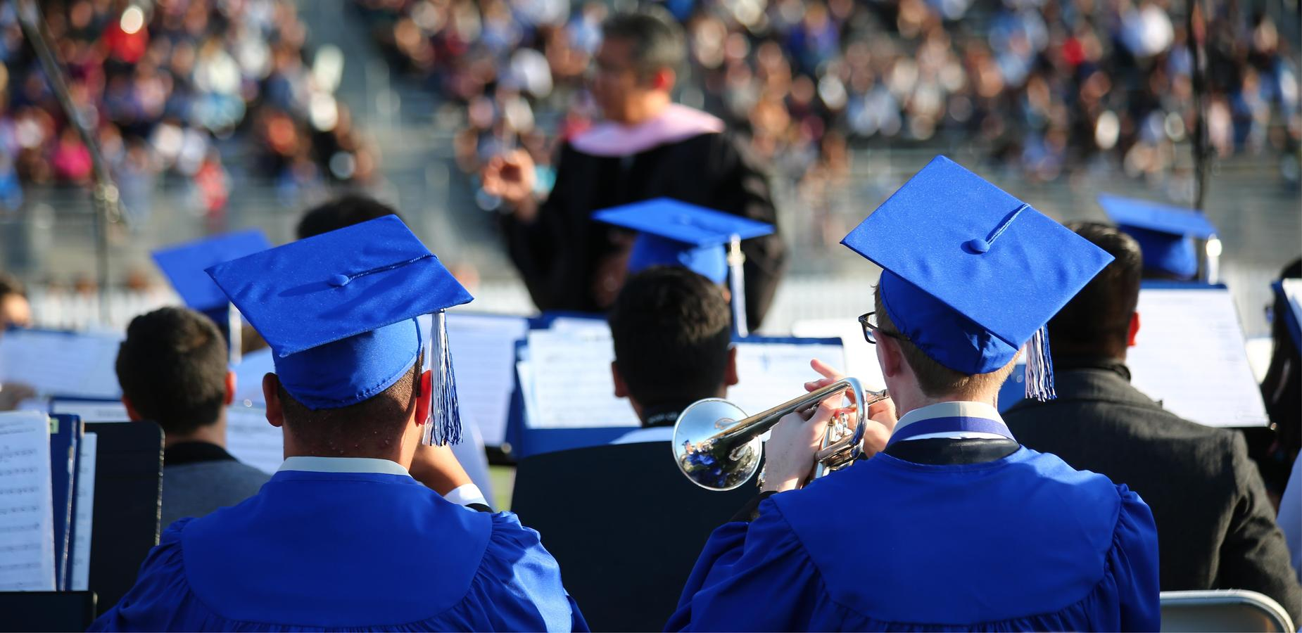 Graduates, and members of DRHS Band perform at their Graduation