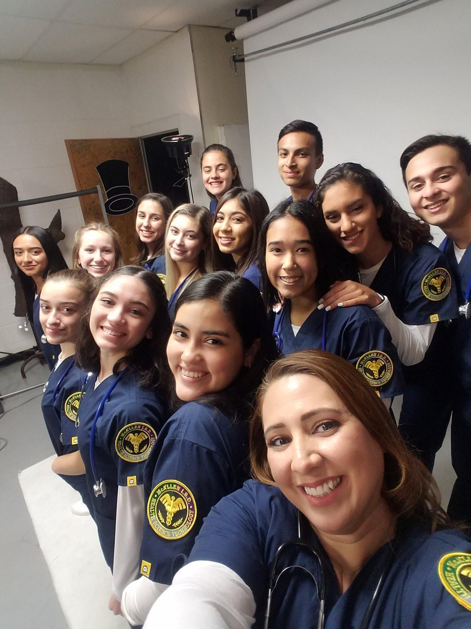 students in medical scrubs posing for picture