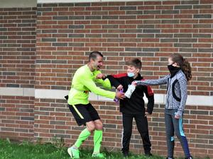 Mr. Bruno accepts some water and snacks from students.
