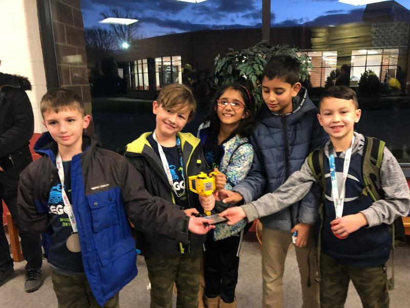 (L-R) Aaron Rudnick, Luke Jenner, Mahie Panjwani, Neev Nedungadi, and Evan Tukaczynski display 2nd Place Award received in the Strategy and Innovation category at the state championship of the First Lego League robotics competition on Dec. 14-15.  Team member Wilson Wright not pictured.